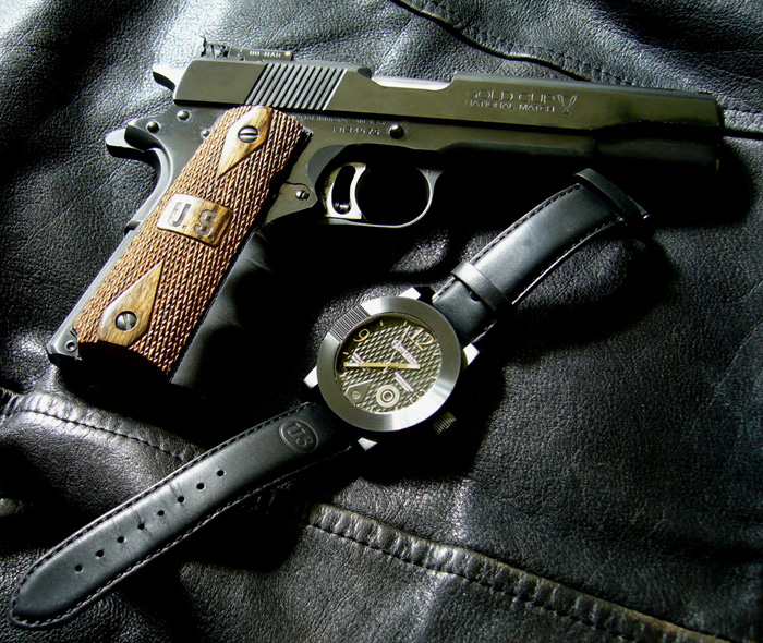 1911 Watch from Morpheus with Colt 1911 pistol